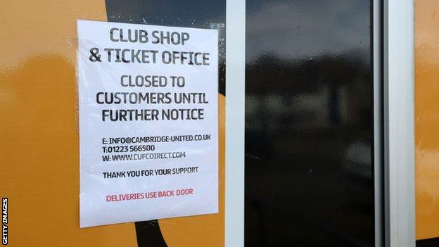 A sign at Cambridge United telling fans the club shop and ticket office is closed