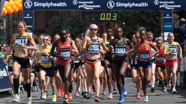 """Runners at the start of the Simplyhealth Great Manchester Elite Women""""s 10k run through Manchester. PRESS ASSOCIATION Photo. Picture date: Sunday May 20, 2018. See PA story ATHLETICS Manchester. Photo credit should read: Martin Rickett/PA Wire"""