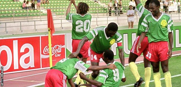 Cameroon celebrate a goal by striker Roger Milla during the 1990 World Cup