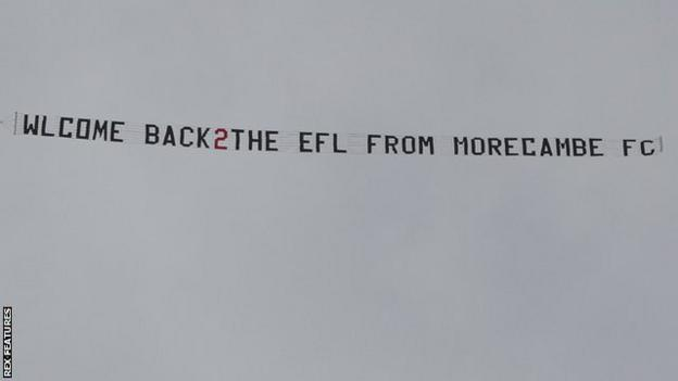 A plane with a banner circles Barrow's ground
