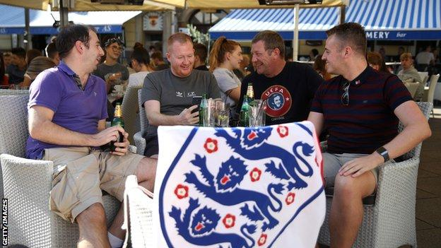 England fans drink in a bar before the game