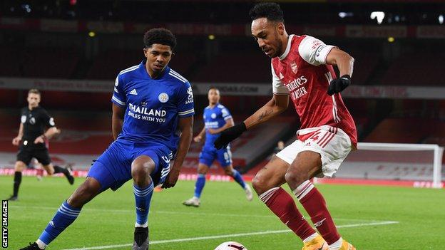Wesley Fofana of Leicester City marks Pierre-Emerick Aubameyang of Arsenal