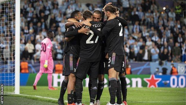 Juventus' players celebrate scoring against Malmo in the Champions League