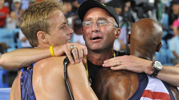 US coach Alberto Salazar (centre) hugs Mo Farah (right) and US athlete Galen Rupp (left)
