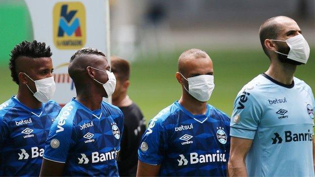 Coronavirus: Gremio players wear masks in on-field protest before Sao Luiz game