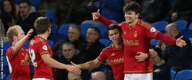 Oliver Burke celebrates with his Nottingham Forest after scoring the opening goal