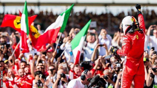 Vettel celebrates winning the British GP