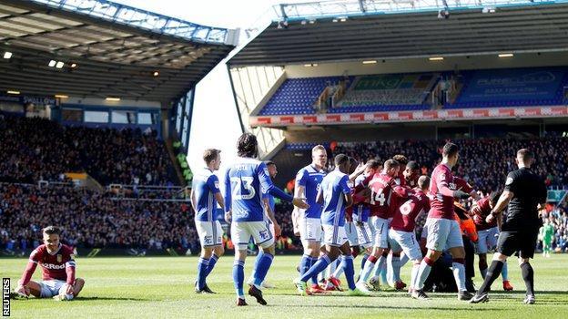 Aston Villa midfielder Jack Grealish sits on the ground following the attack