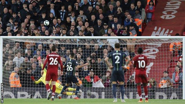 Riyad Mahrez fires his penalty over the bar at Anfield last season