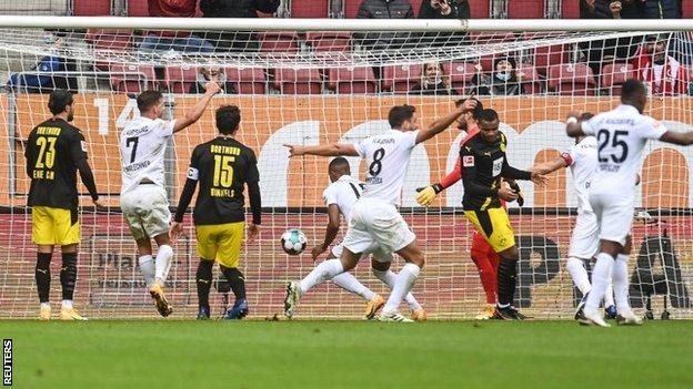 Augsburg celebrate the opening goal against Borussia Dortmund on Saturday