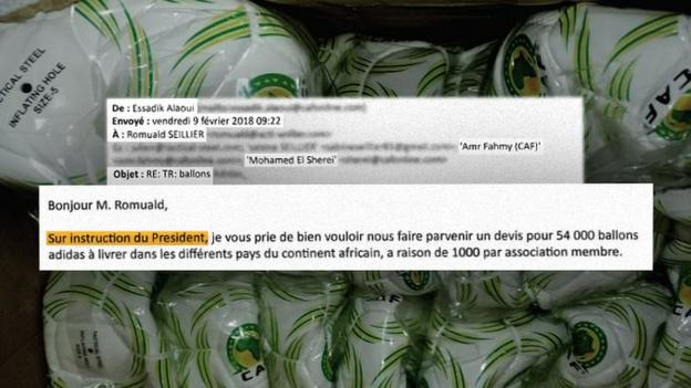 Excerpts of an email from Caf to Tactical Steel owner Romuald Seillier, with some of the 60,000 footballs in the background