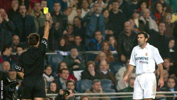 Luis Figo booked