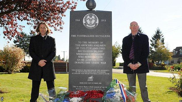 Wycombe manager Gareth Ainsworth (left) and Phil Stant beside the memorial in Longueval in 2010