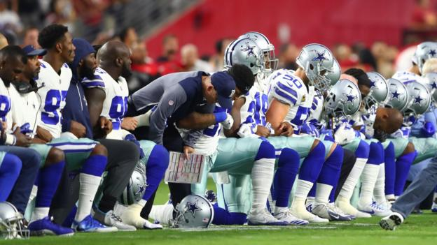 Dallas Cowboys players and owner Jerry Jones take a knee before national anthem - BBC Sport