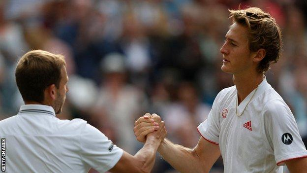 Dan Evans and Sebastian Korda shake hands at the net