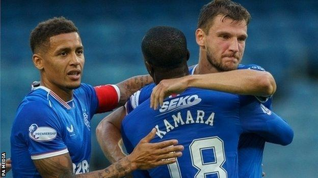 Rangers celebrate the opening goal from Borna Barisic (right)