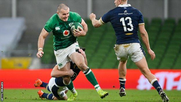 Ireland's Jacob Stockdale runs with the ball against Scotland