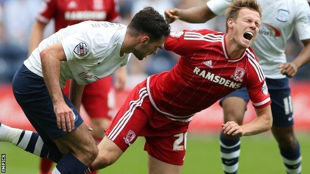 Preston North End's Greg Cunningham (l) tackles Middlesbrough's Tomas Kalas (right)