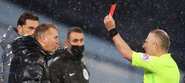 Dean Smith is sent off by referee Jon Moss