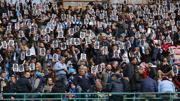Fans wear Kalidou Koulibaly masks at Napoli's Serie A game against Carpi