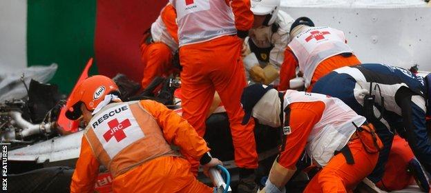 Jules Bianchi is attended to by paramedics following his crash at Suzuka in 2014