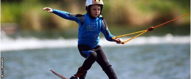 child wakeboarding