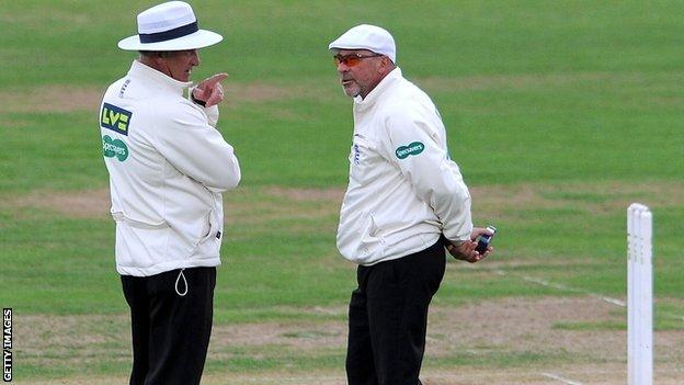 Umpires Peter Hartley and Tim Robinson