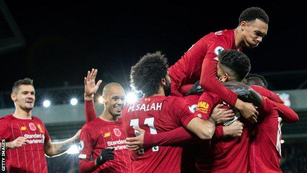 Liverpool players celebrate Sadio Mane's goal against Premier League rivals Manchester City in November