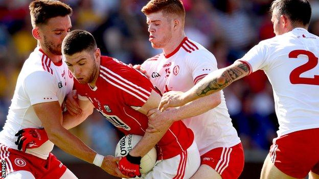 There's no way out for Cork forward Luke Connolly as a trio of Tyrone players close in