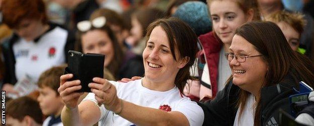 Katy Daley-Mclean takes a selfie with a fan in Exeter