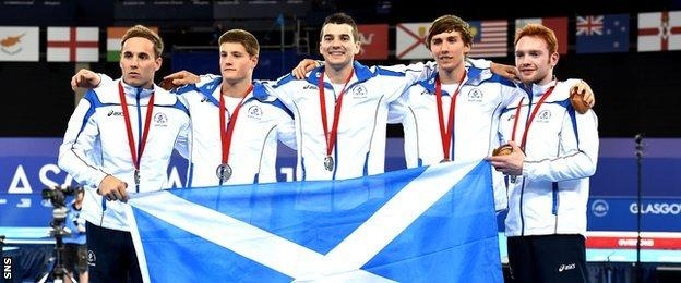 Team Scotland with medals after Glasgow 2014 Commonwealth Games