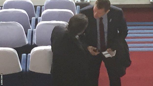 Steve Cotterill (r) talking to Nottingham Forest chairman Fawaz Al Hasawi