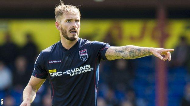 Martin Woods in action for Ross County