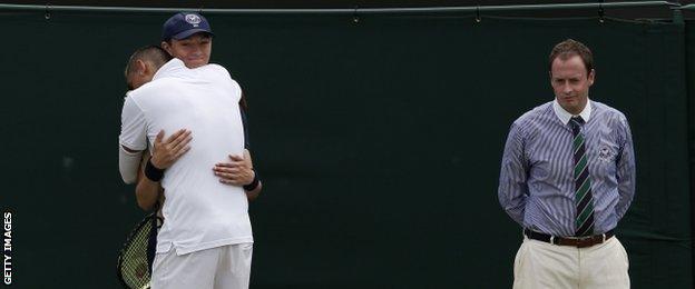 Nick Kyrgios hugs a ball boy