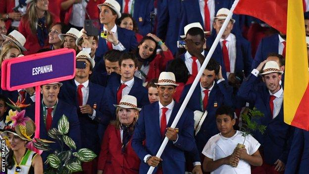 Rafael Nadal carries the Spanish flag at the opening ceremony of the Rio 2016 Olympic Games