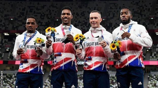 Team GB's men's 4x100m silver medallists on the podium in Tokyo