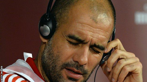 Pep Guardiola listens to headphones