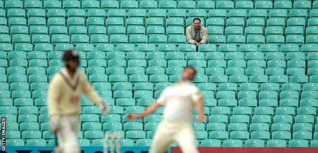 A lone spectator looks on during a County Championship match between Surrey and Nottinghamshire at the Oval in 2016