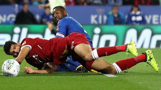 Liverpool's Dominic Solanke is challenged during their Carabao Cup defeat by Leicester