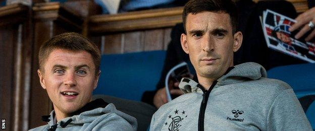 Rangers defender Lee Wallace (right) with Jordan Rossiter