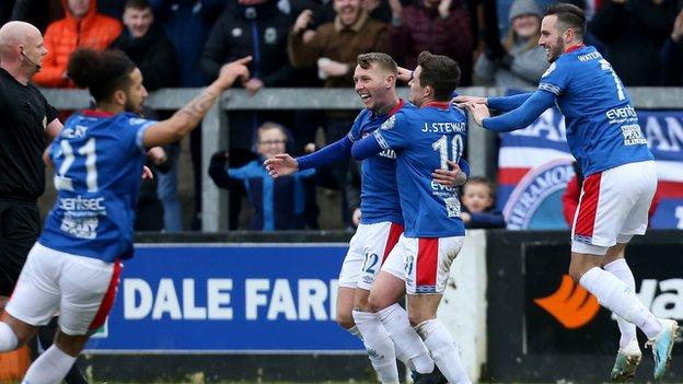 Linfield's Kirk Millar is congratulated after netting against Carrick Rangers in March