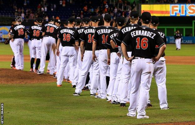 Players wore black shirts with Fernandez' name and number on the back