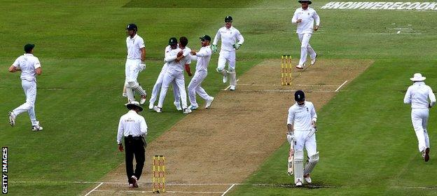 Dale Steyn of South Africa celebrates taking the wicket of Alastair Cook