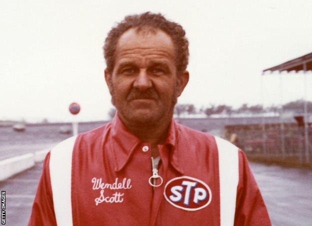 Wendell Scott HAMPTON, GA — 1973: Wendell Scott of Danville, VA, at Atlanta International Raceway during his final year of competition on the NASCAR Cup circuit. During his career, Scott started 495 Cup events, won once, and finished in the top 10 position 147 times. (Photo by ISC Images & Archives via Getty Images)