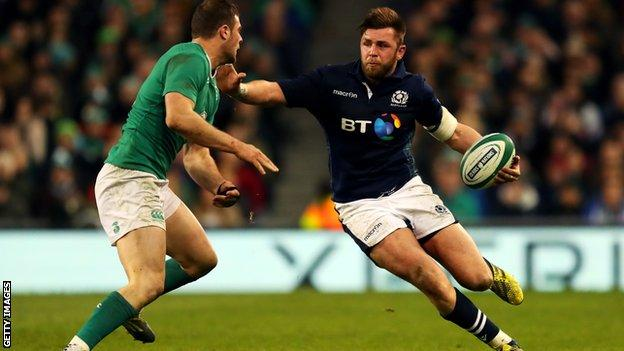 Ryan Wilson carries for the ball for Scotland against Ireland in last year's Six Nations