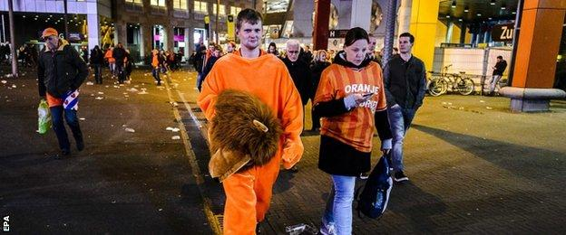 Dutch supporters after their team's defeat in Amsterdam