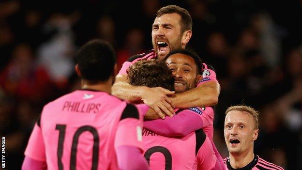 James McArthur (top) celebrates with Scotland against Slovenia