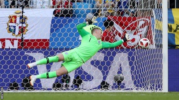 England keeper Jordan Pickford makes a save against Sweden in the World Cup quarter-final