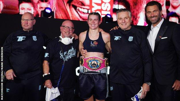 Marshall celebrates her world title win with her team