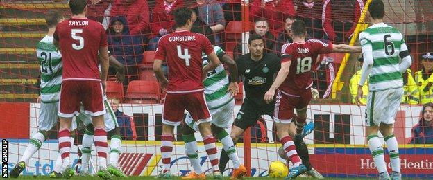 Paul Quinn steers in the late winner for Aberdeen